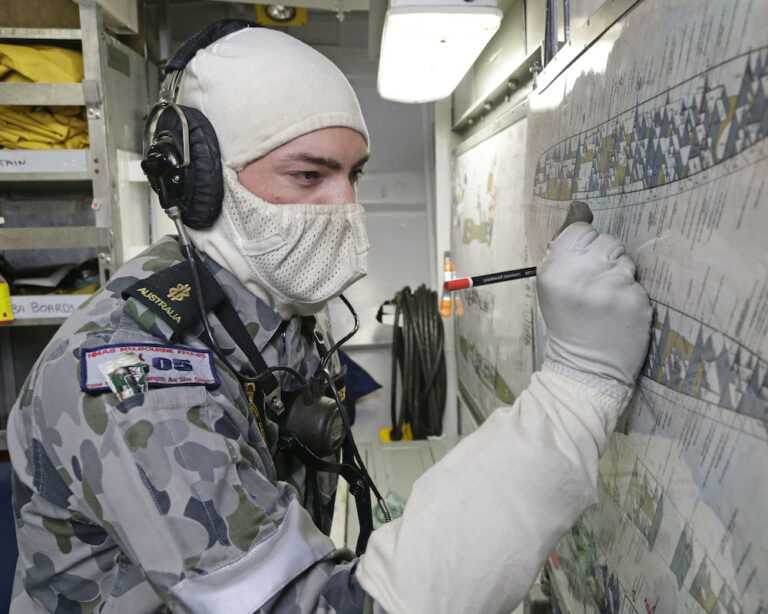 Why do navy personnel use odd white masks?