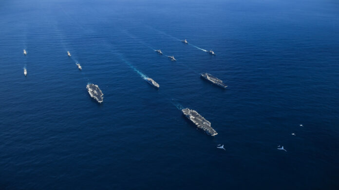The USS Ronald Reagan (CVN 76), USS Theodore Roosevelt (CVN 71) and USS Nimitz (CVN 68) Strike Groups transit the Western Pacific with ships from the Japan Maritime Self-Defense Force. The strike groups are underway and conducting operations in international waters as part of a three-carrier strike force exercise. The U.S. Navy has patrolled the Indo-Asia Pacific region routinely for more than 70 years promoting regional security, stability and prosperity. (U.S. Navy photo)