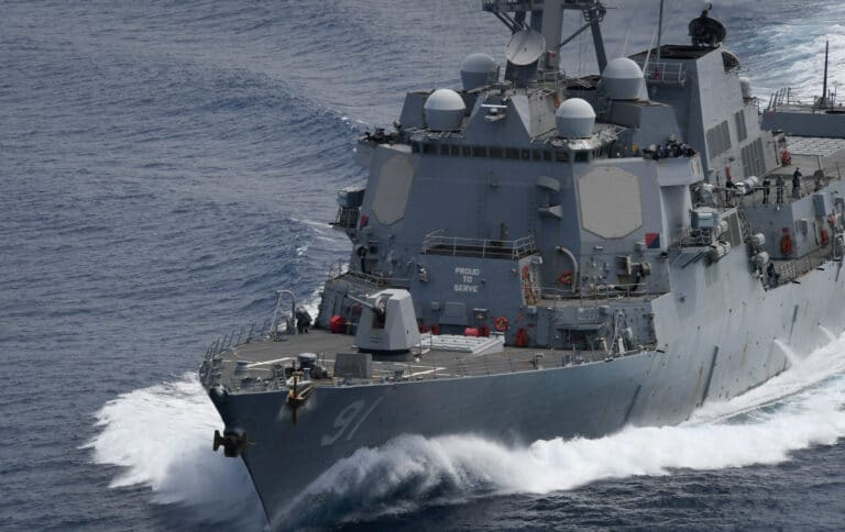 U.S. Navy assets conduct freedom of navigation operations in different regions