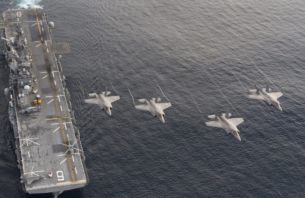 four f 35b lightning ii aircraft perform a flyover above the amphibious assault ship uss america lha 6 during the lightning carrier proof of concept demonstration 30357956614 - naval post- naval news and information