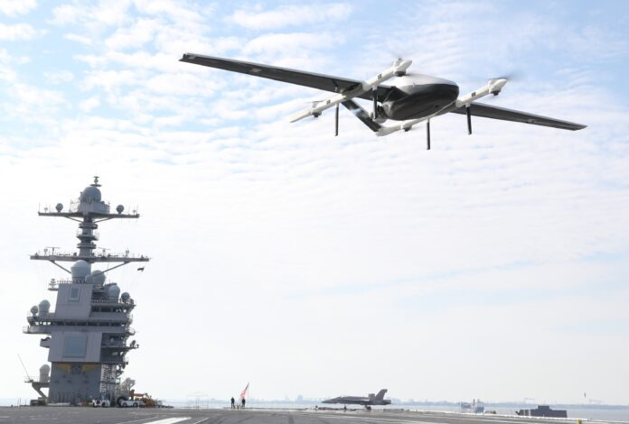 A logistics Unmanned Air System (UAS) prototype, called Blue Water UAS, approaches to deliver cargo on USS Gerald R. Ford's (CVN 78) flight deck during supply demonstration Feb. 21, 2021. The test was successfully conducted by transporting light-weight logistical equipment from one part of Naval Station Norfolk aboard Ford while the aircraft carrier was in port. (U.S. Navy photo)