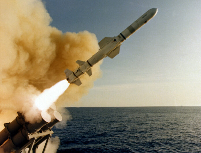 A view of an RGM-84 surface-to-surface Harpoon missile, immediately after leaving a canister launcher aboard the cruiser USS LEAHY (CG-16), near the Pacific Missile Test Center, Calif.