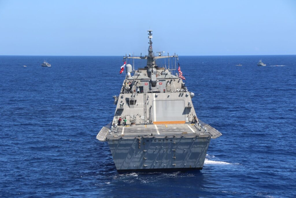 the freedom-variant littoral combat ship uss wichita (lcs 13) conducts a bi-lateral maritime exercise with naval counter parts from the dominican republic, march 24, 2021.
