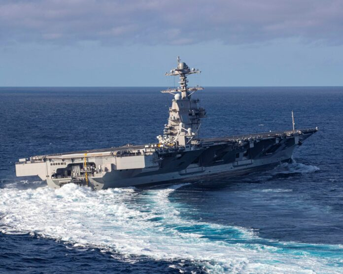USS Gerald R. Ford (CVN 78) conducts high-speed turns in the Atlantic Ocean. Ford is at sea conducting sea trials following the in port portion of its 15 month post-shakedown availability. (U.S. Navy photo)