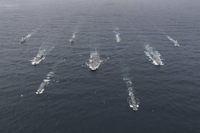 The full United Kingdom (UK) Carrier Strike Group (CSG) assembled at sea. The CSG is led by the Royal Navy aircraft carrier HMS Queen Elizabeth (R 08) and includes flotilla of destroyers and frigates from the UK, the Netherlands, the U.S. Navy guided-missile destroyer USS The Sullivans (DDG 68), and 15 F-35B Lightning II's from Marine Fighter Attack Squadron 211 and the UK's 617 Squadron. (U.S. Navy photo courtesy of the Royal Navy)