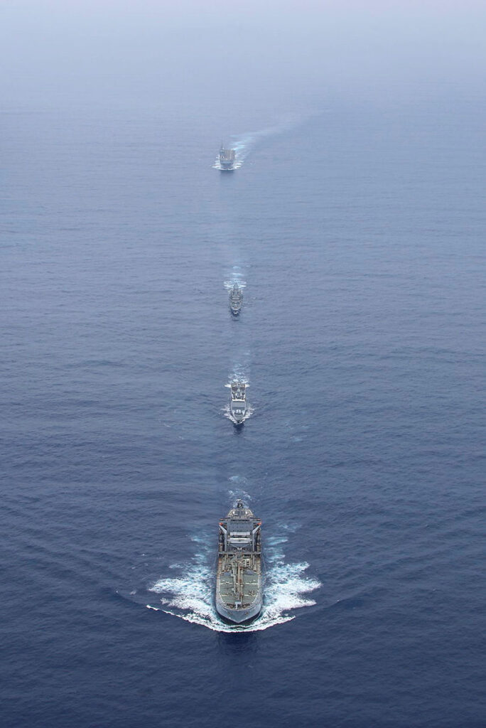 hmas sirius lead hmas anzac and french navy ships fs tonnerre and fs surcouf of the jeanne d'arc task group as they sail in-company through the south china sea.