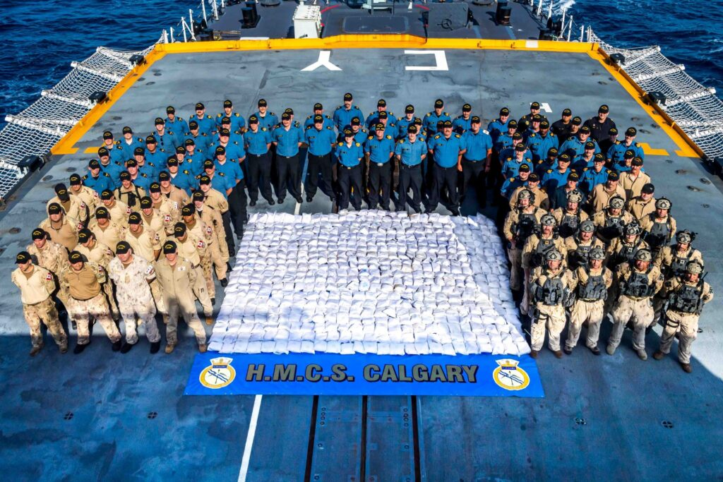 members of hmcs calgary stand with 1286kg of heroin seized from a dhow during a counter-smuggling operation on 23 april, 2021 in the arabian sea during operation artemis and as part of combined task force 150