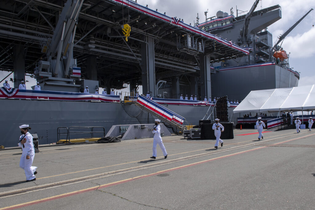 the crew of the lewis b. puller-class expeditionary mobile base uss miguel keith (esb 5) prepare to board the ship during the ship's commissioning ceremony (us navy photo)