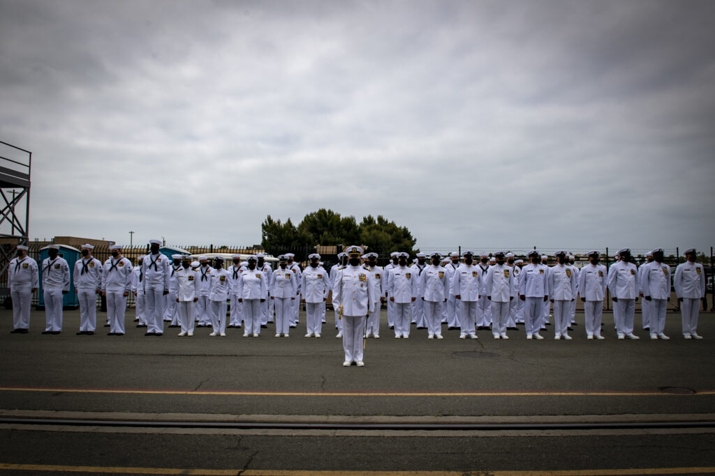 the crew of the lewis b. puller-class expeditionary mobile base uss miguel keith (esb 5) stand in formation during the ship's commissioning ceremony (us navy photo)
