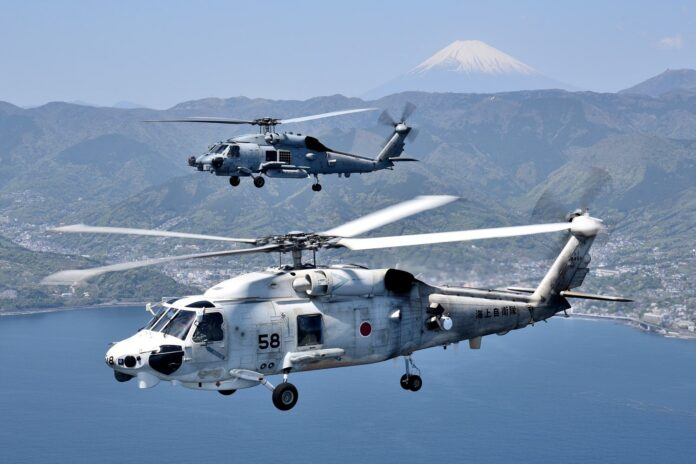 JMSDF patrol aircraft SH-60K conducted bilateral training with USN patrol aircraft MH-60R in the waters and airspace of Sagami Bay. (File Photo)