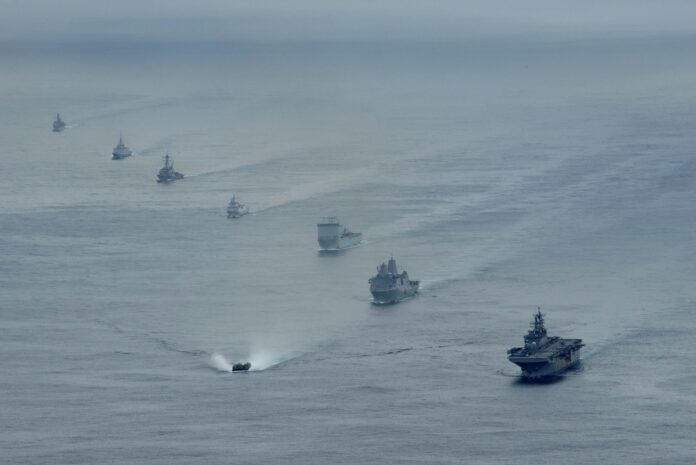 Ships from the U.S. Navy's Iwo Jima Amphibious Ready Group (IWOARG), the Royal Navy's Queen Elizabeth Carrier Strike Group and the French and Norwegian navies transit the Atlantic Ocean in formation during a photo exercise, May 17, 2021. (U.S. Navy Photo)