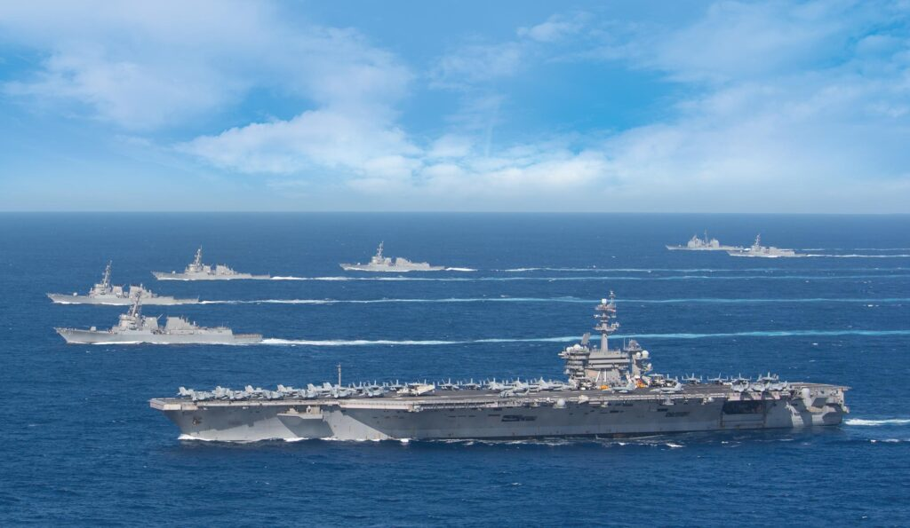 the uss theodore roosevelt carrier strike group transits in formation while deployed in the indo-pacific region in january 2020. (us navy photo)
