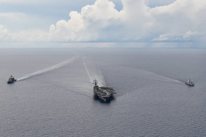 Guided-missile cruiser USS Shiloh (CG 67), the U.S. Navy's only forward-deployed aircraft carrier, USS Ronald Reagan (CVN 76), and Republic of Singapore Navy stealth frigate RSS Intrepid (69) steam in formation in the South China Sea.