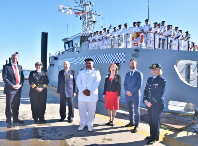 From left: Austal CEO Patrick Gregg, RADM Wendy Malcolm CSM RAN, Honorary Consul General to Kiribati Mr Paul Wenham, Superintendent of Police and Commanding Officer of RKS Teanoai II, Tom Redfern, Mrs Ilona Wenham, Mr Vince Connelly MP, Member for Stirling and Air Commodore Fiona Dowse, Senior Officer ADF Western Australia, with the crew of the RKS Teanoai II at Austal's Henderson Western Australia shipyard.