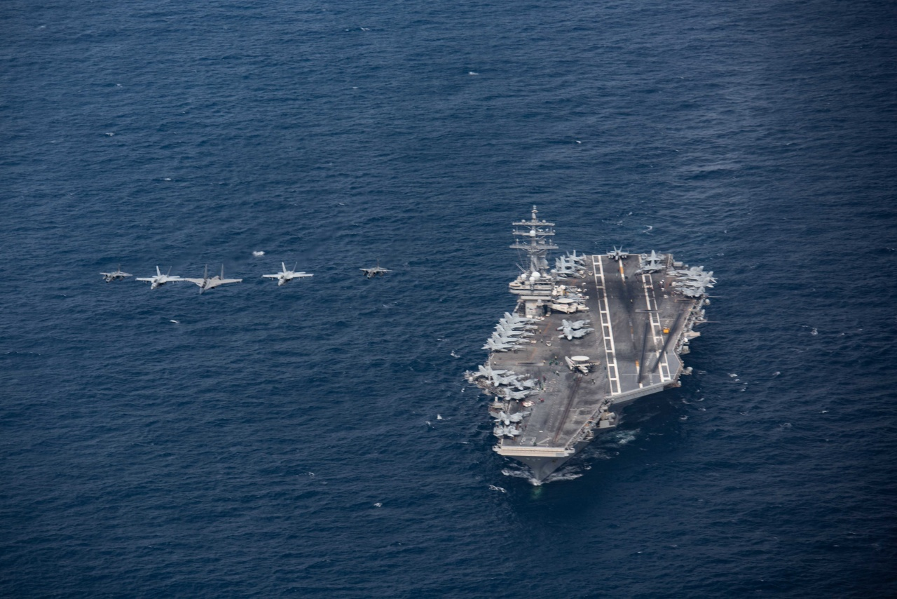 Aircraft assigned to Carrier Air Wing (CVW) 5 and Indian air force aircraft fly in formation over the U.S. Navy's only forward-deployed aircraft carrier USS Ronald Reagan (CVN 76). Ronald Reagan, the flagship of Carrier Strike Group 5, provides a combat-ready force that protects and defends the United States, as well as the collective maritime interests of its allies and partners in the Indo-Pacific region. (Photo US Navy)