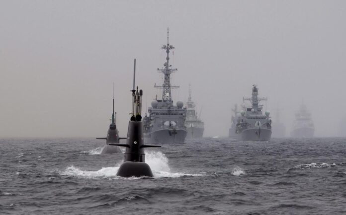 Submarines and warships are in formation