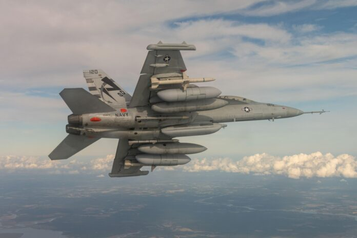 An EA-18G Growler from Air Test and Evaluation Squadron (VX) 23, located at Naval Air Station Patuxent River, Maryland, conducts a Next Generation Jammer Mid-Band (NGJ-MB) flight test over Southern Maryland recently. VX-23 supports the overall NGJ-MB Test and Evaluation program that has seen more than 145 hours of flight test. NGJ-MB received Milestone C approval June 28 and support to award Low Rate Initial Production contract. (U.S. Navy photo)