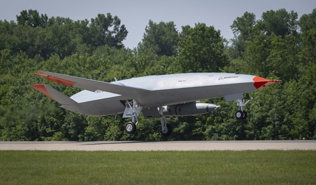 an unmanned boeing mq-25 t1 stingray test aircraft takes off from midamerica airport in mascoutah, illinois to conduct an aerial refueling test with a manned f/a-18 super hornet, june 4, 2021.