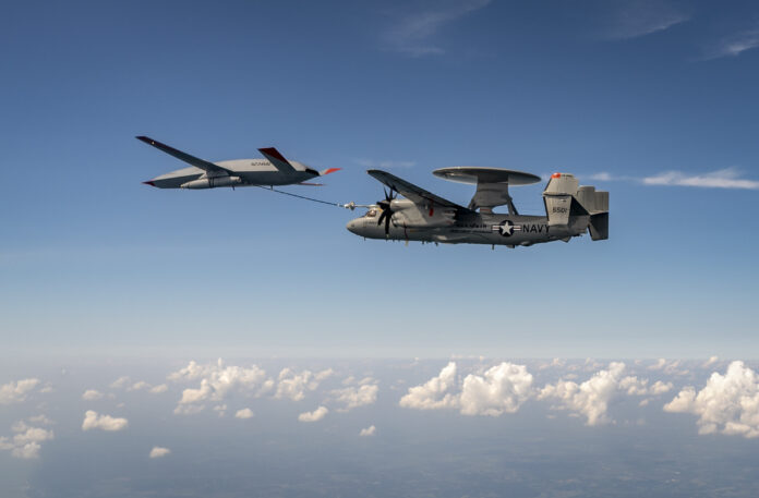 An MQ-25 Stingray unmanned aerial vehicle refuels an E-2D Advanced Hawkeye aircraft over MidAmerica Airport in Mascoutah, Ill,, Aug. 18, 2021.