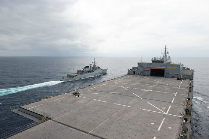 Brazilian Navy frigate Independencia (F-44) executes a manuever on the port side of the Expeditionary Sea Base USS Hershel