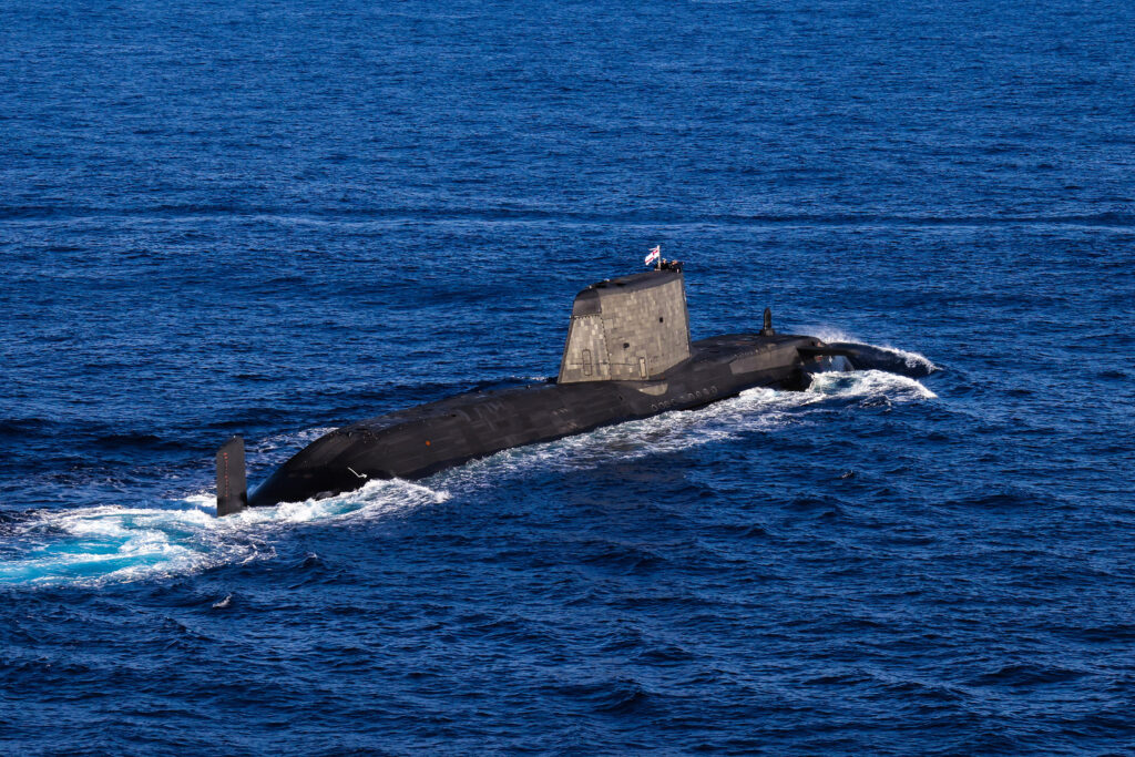a rare appearance on the surface for an astute class submarine accompanying the carrier strike group - naval post- naval news and information