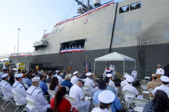 Capt. Larry Repass, commanding officer of Freedom-variant littoral combat ship USS Freedom (LCS 1) delivers remarks during Freedom's decommissioning ceremony. Freedom was decommissioned after more than 10 years of service. Commissioned Nov. 8, 2008, Freedom has been a test and training ship and was key in developing the operational concepts foundational to the current configuration and deployment of LCS today.