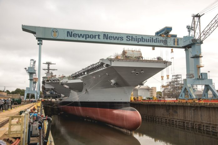 The flooding of Dry Dock 12, which began on Tuesday at Newport News Shipbuilding, was the first time the aircraft carrier John F. Kennedy (CVN 79) touched water. The ship will be christened in December. Photo by Ashley Cowan/HII